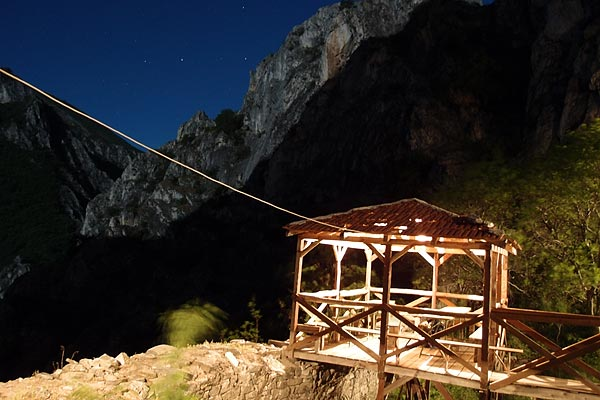 Sv. Nikola monastery and Matka wall (Otmar's rock) in the moonlight